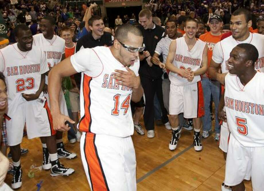 Sam Houston's Gilberto Clavell, front, and teammates were in a mood for dancing after beating Stephen F. Austin, 64-48, in the Southland Conference tournament championship game Saturday at the Merrell Center. Photo: Bob Levey, AP