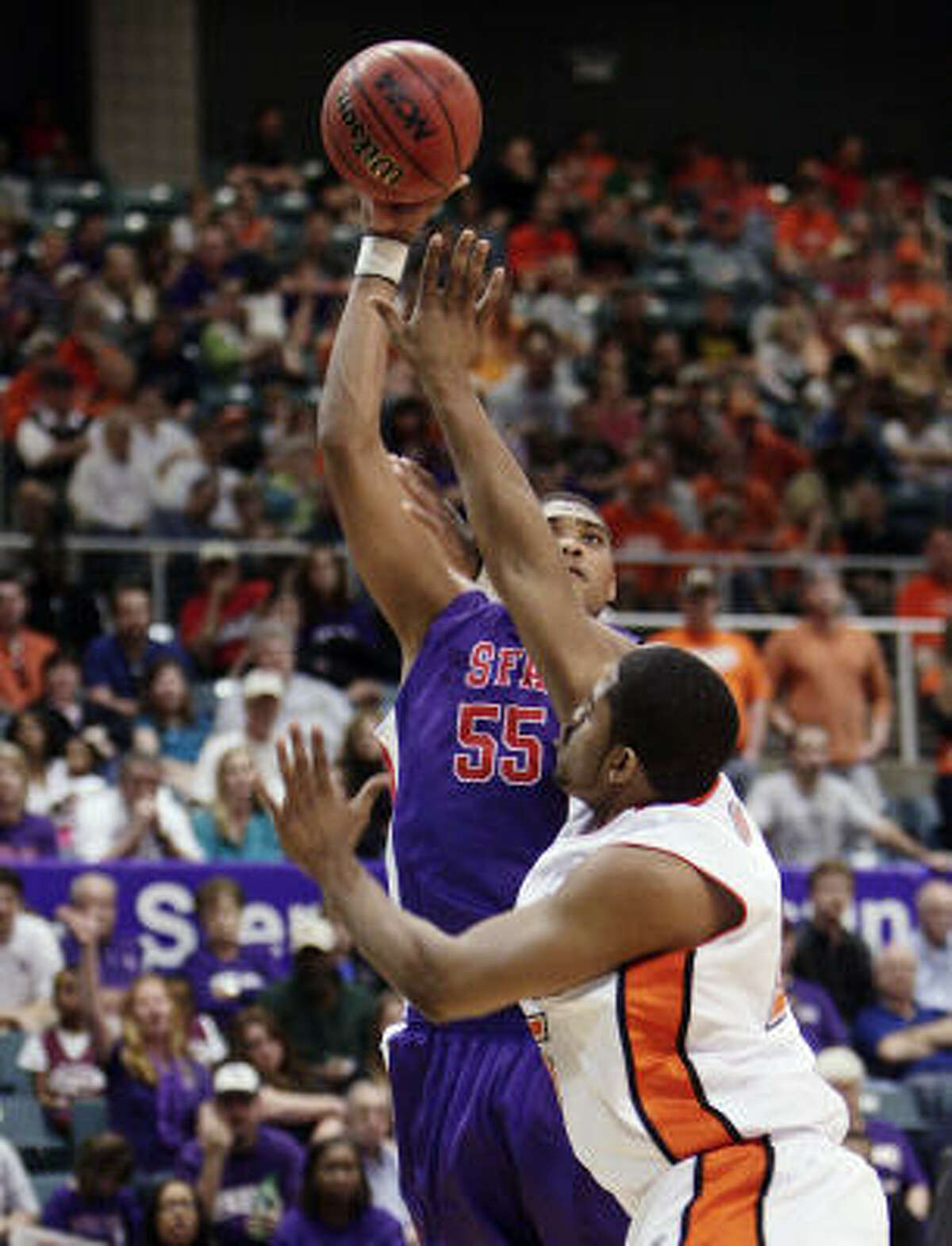 SFA's Jereal Scott shoots over Sam Houston's Antuan Bootle in the second half.