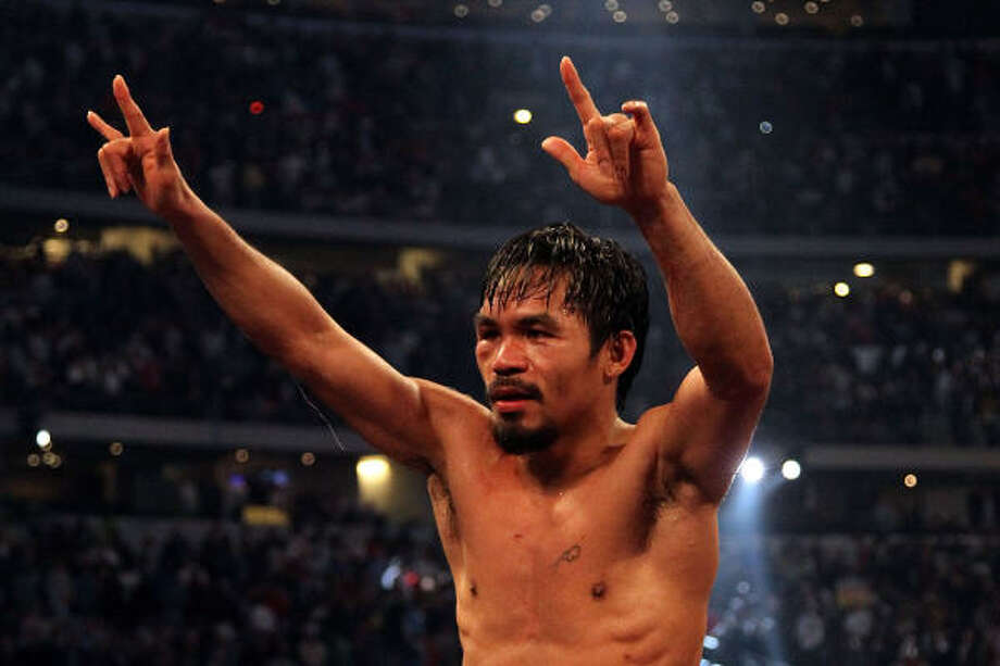 Manny Pacquiao celebrates in the ring after defeating Joshua Clottey. Photo: Jed Jacobsohn, Getty Images