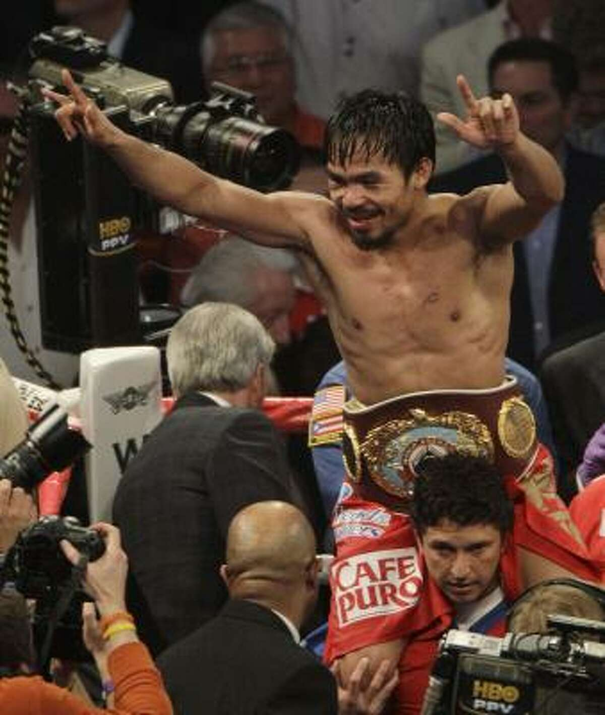 Manny Pacquiao celebrates after defeating Joshua Clottey.