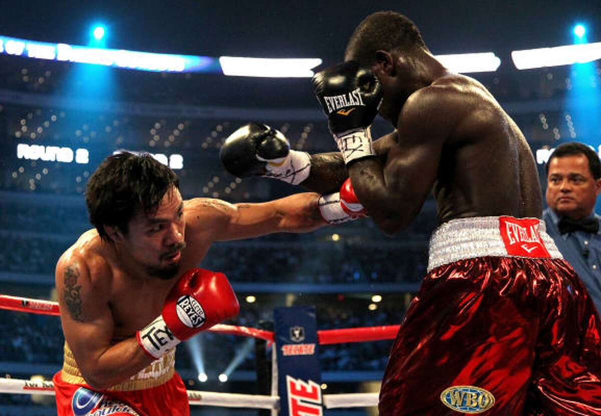 Manny Pacquiao throws a left to the body of Joshua Clottey.