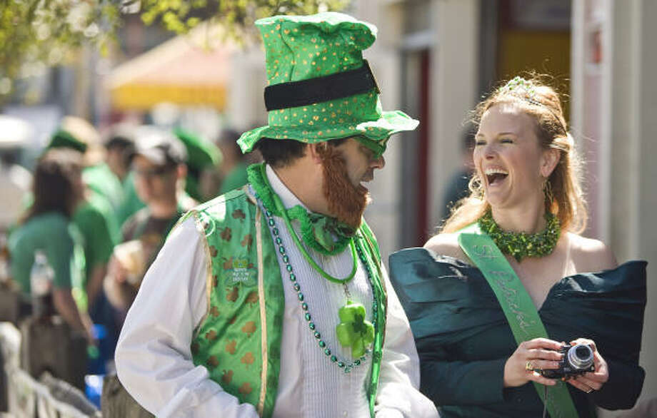 Steve Rains, left, of Houston gets a chance to make Stacy Ryan, the St. Patrick's Day Parade queen laugh before the 51st Annual St. Patrick's Day Parade. Photo: Nick De La Torre, Chronicle