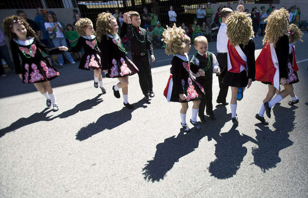 Members of the McTeggart Irish Dancers perform for the 51st Annual St. Patrick's Day Parade's grand stand.