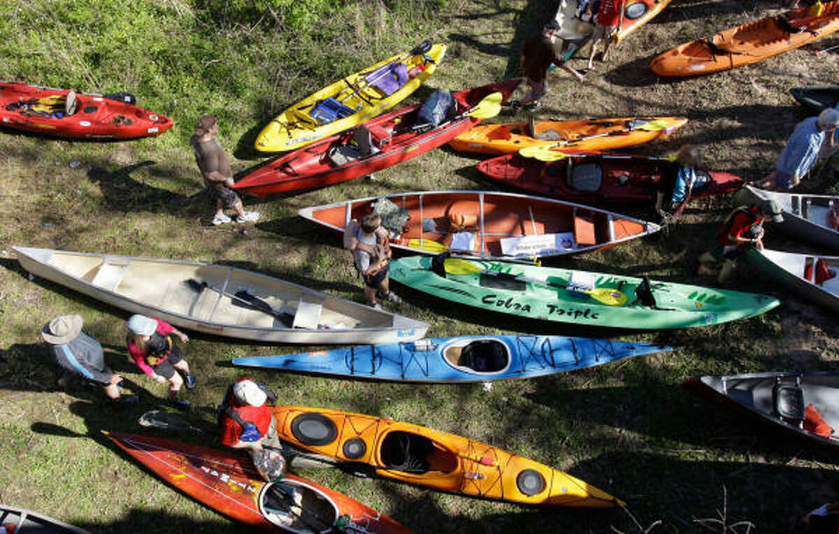 A staging area at the 38th Annual Buffalo Bayou Regatta where over 400 boats and 600 people participated in the 15 mile race that began at San Felipe near Voss and finished downtown at Sesquicentennial Park. The event is held by the Buffalo Bayou Partnership, a non-profit organization dedicated to enhancing Houston's historic waterway. It is billed as Texas' largest canoe and kayak race. There are 6 different boat divisions and 4 different group starts. The fastest finish time is 1 hour 50 minutes, but the average finish time is around 2 1/2 to 3 hours.