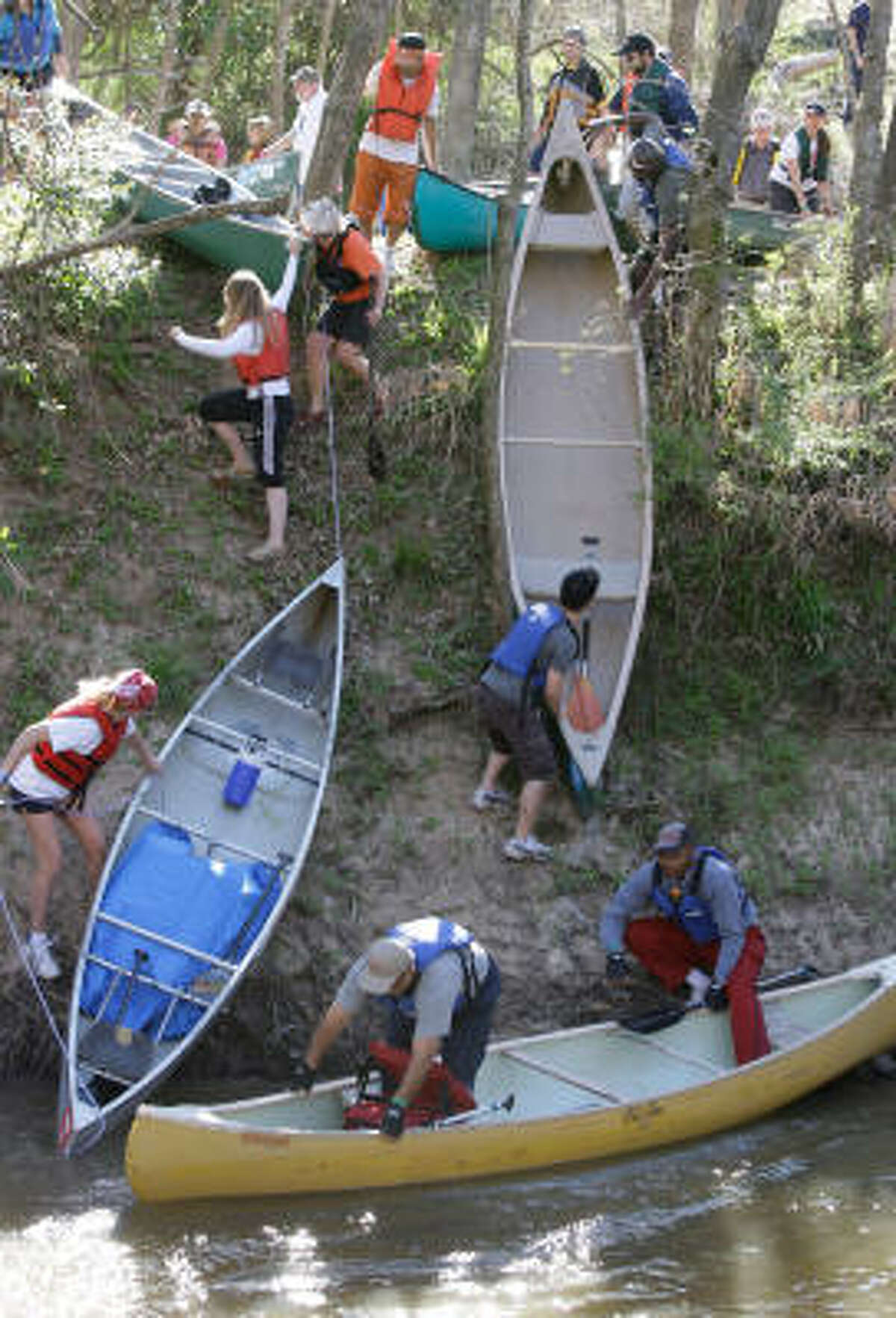 People work to get their canoes into water at the 38th Annual Buffalo Bayou Regatta.