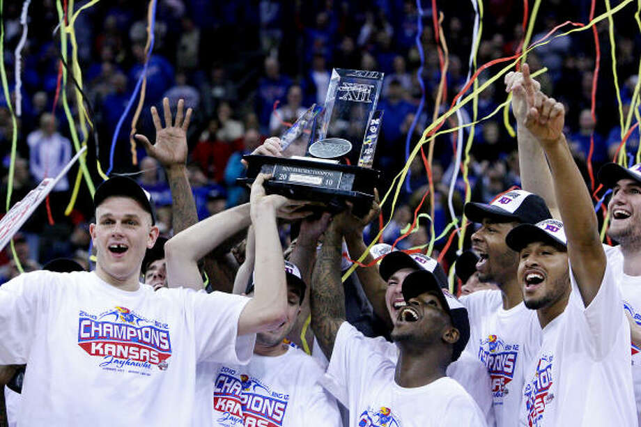 March 13: Kansas 72, Kansas State 64Kansas players celebrate their Big 12 Tournament win over in-state rival Kansas State. Photo: Rich Sugg, MCT