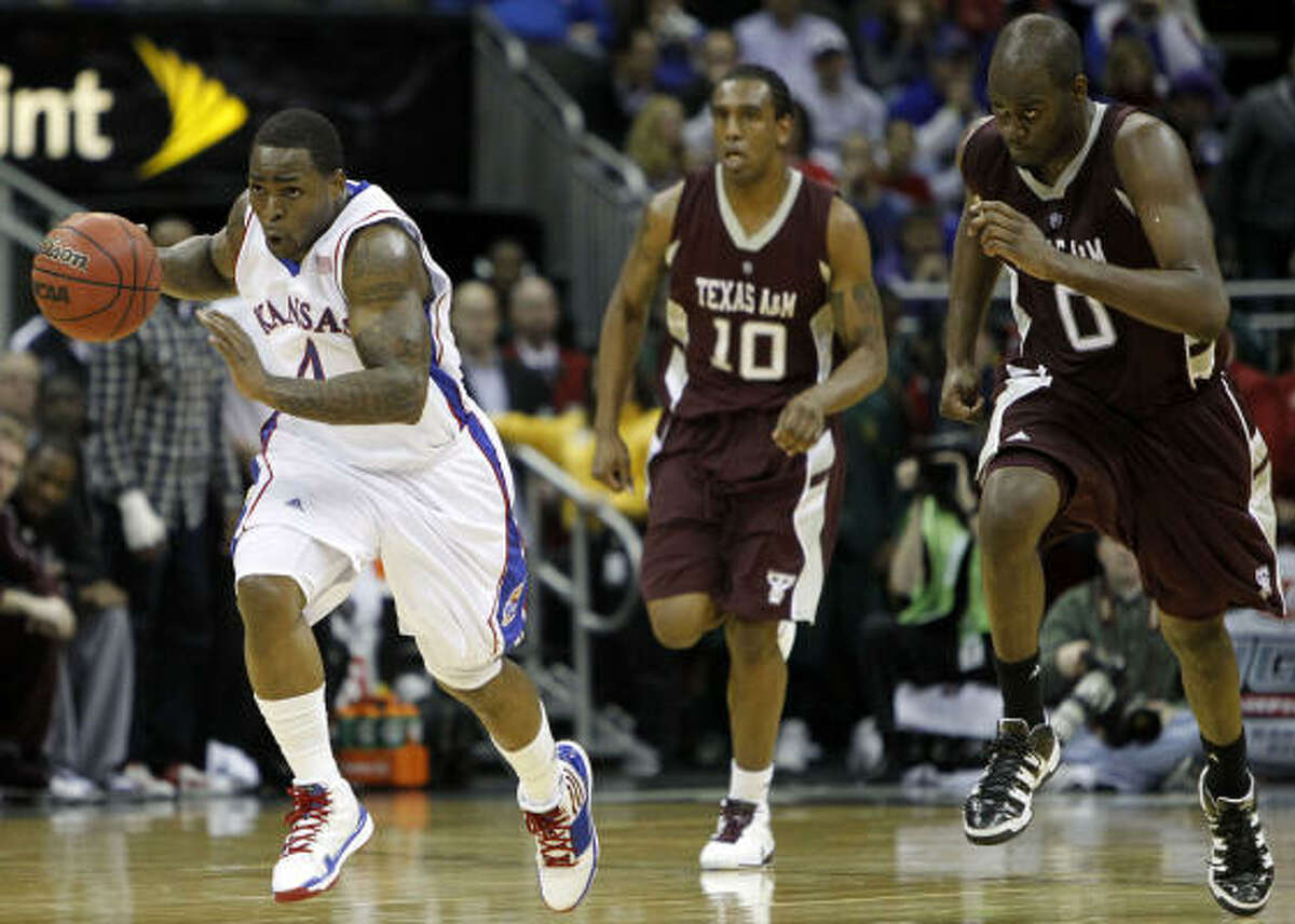 March 12: Kansas 79, Texas A&M 66 Texas A&M had problems keeping up with Kansas guard Sherron Collins, left, who scored 26 points to lead the Jayhawks to a win over the Aggies in the semifinals of the Big 12 tournament. Kansas advances to face Kansas State in Saturday's championship game.