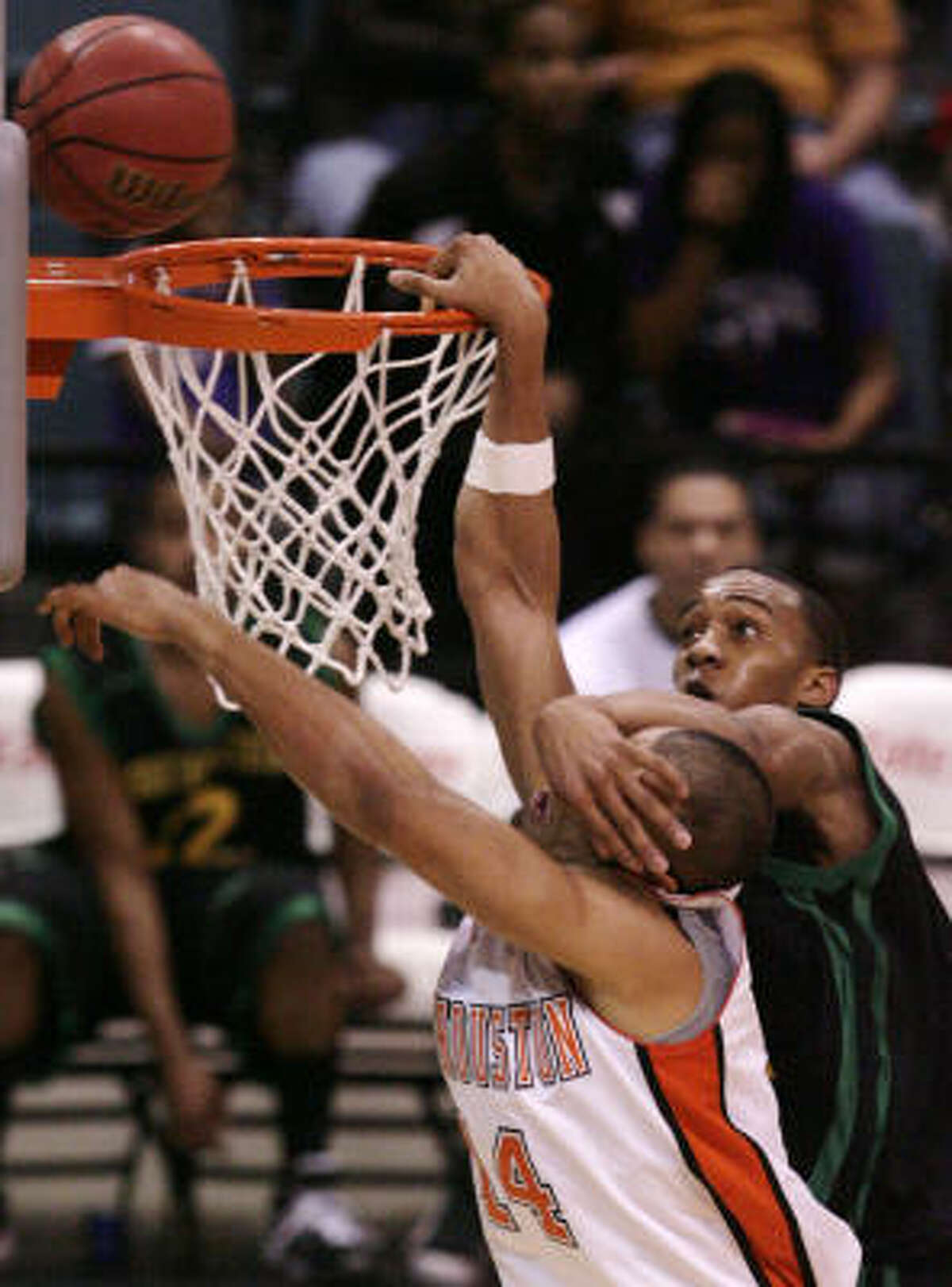 March 11: Sam Houston State 88, Southeastern Louisiana 85 Sam Houston State forward Gilberto Clavell on an attempted dunk takes a hand to the face from Southeastern Louisiana center Patrick Sullivan during the semifinals of the Southland Conference Tournament in Katy.