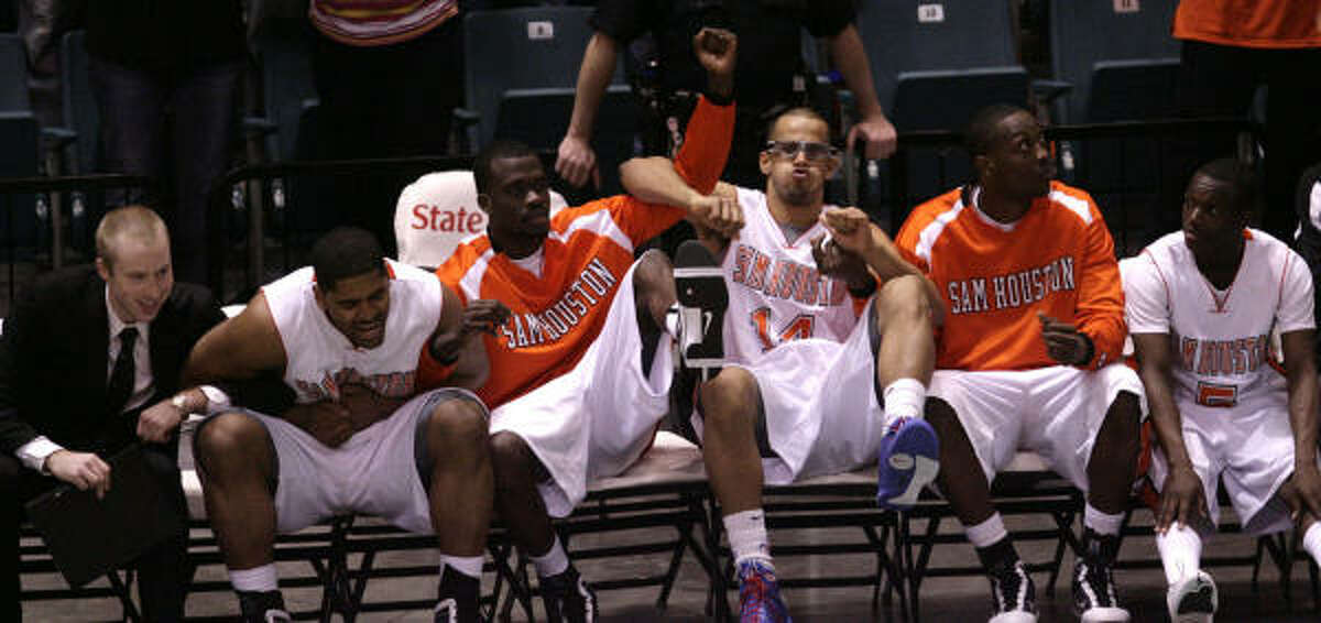 The Sam Houston State bench celebrates with seconds left in the game as they take the lead against Southeastern Louisiana.