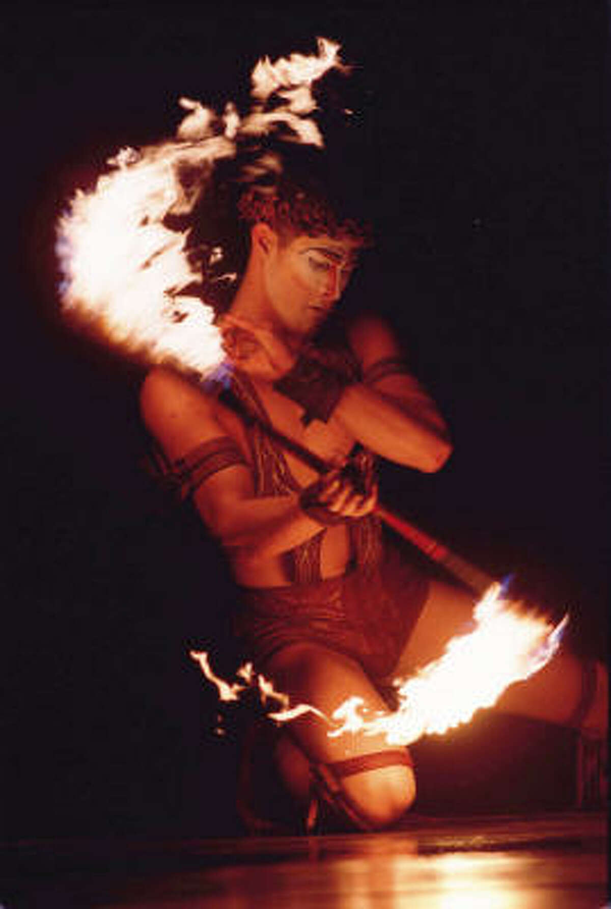 The show features a tribal dance to the rhythm of Congo drums by artists weaving their baton-like fire knives around their entire body, from the feet to the palms to the mouth.