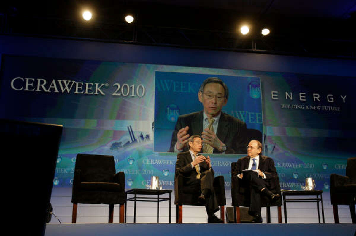 U.S. Energy Secretary Steven Chu, left, speaks with IHS CERA chairman Daniel Yergin during CERAWeek 2010 at the Hilton Americas Hotel Tuesday, March 9, in Houston. This is the IHS Cambridge Energy Research Associates 29th executive conference.