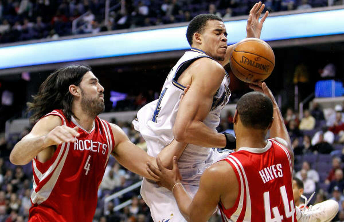 Luis Scola, left, had 23 points and 10 rebounds in Tuesday's 96-88 win at Washington.