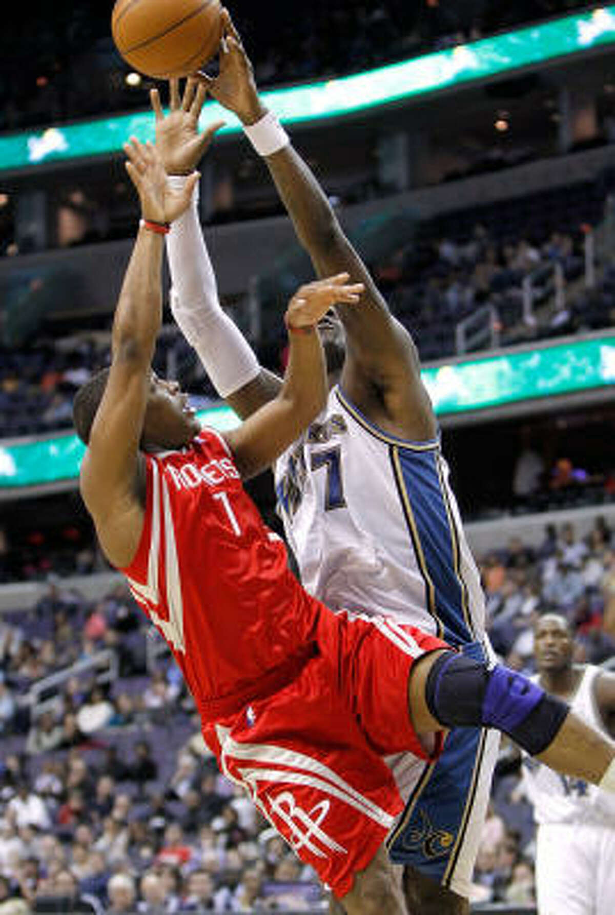 Rockets guard Kyle Lowry gets a shot blocked by Andray Blatche.