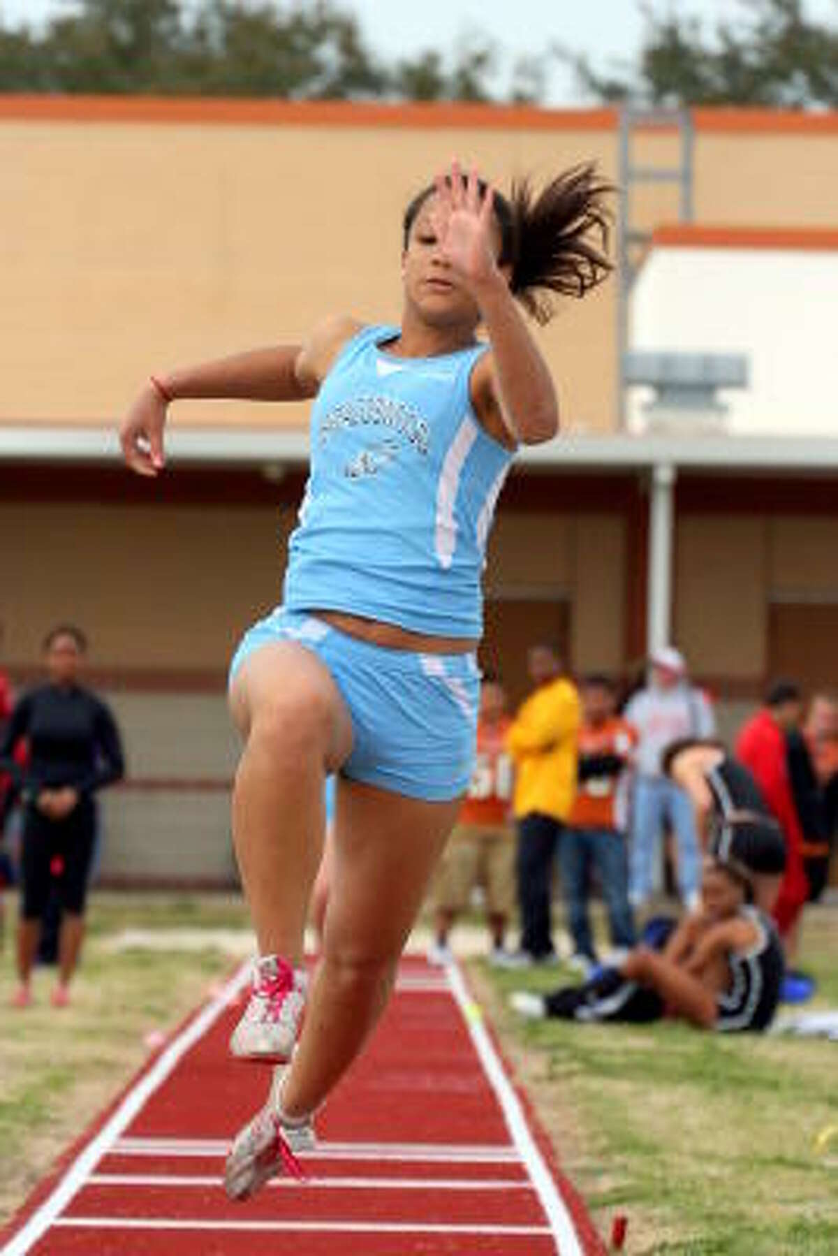 Brazoswood's Briteney Bass leaps during the triple jump event.