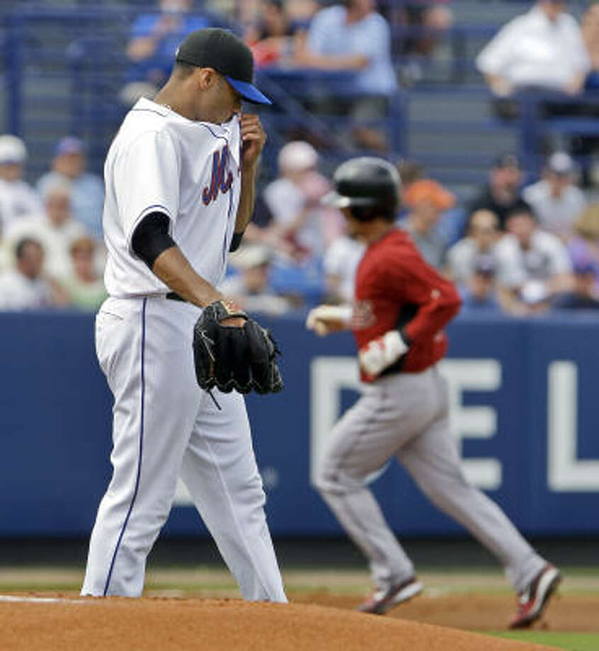 Kaz Matsui rounds the bases after hitting a solo home run off Johan Santana in the first inning. Matsui went 2 for 2. Photo: Richard Drew, AP