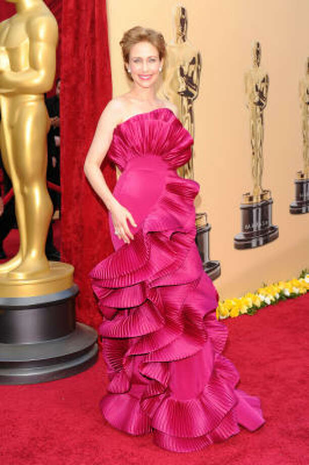 FLOWER OR FASHION? Vera Farmiga wears a fuchsia Marchesa ruffle gown that is almost too overpowering. Photo: Alberto E. Rodriguez, Getty Images