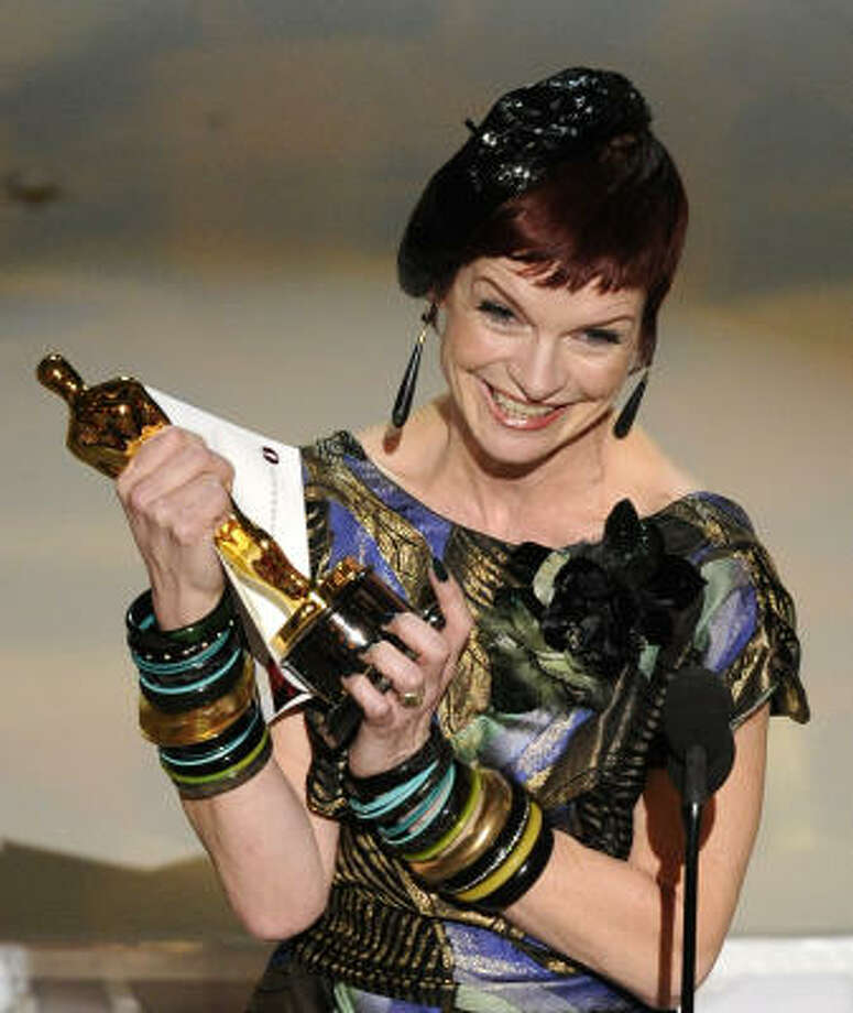 CIAO, SWEETIE: Sandy Powell's beret and way-too-many bracelets are not the right place for an awards night. Photo: Mark J. Terrill, AP