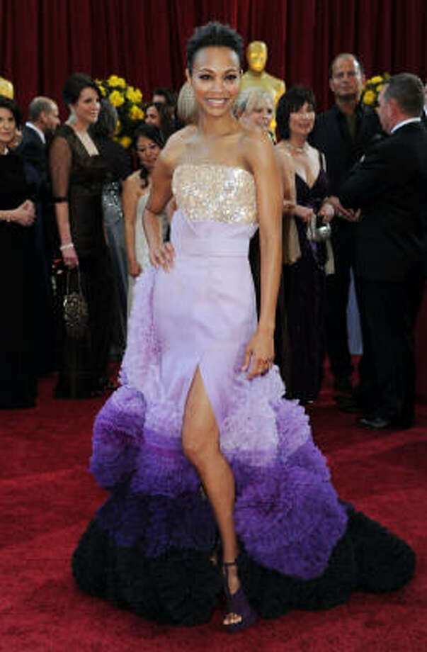 PURPLE HAZE: Avatar star Zoe Saldana looks like a cotton candy mess in this graduated purple gown. Photo: Frazer Harrison, Getty Images