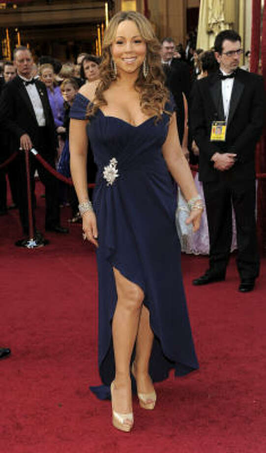 QUEEN OF TACKY: We can't help but dis Mariah Carey in this blue strapless gown with a high split and revealing neckline. Just plain tacky. Photo: Chris Pizzello, AP