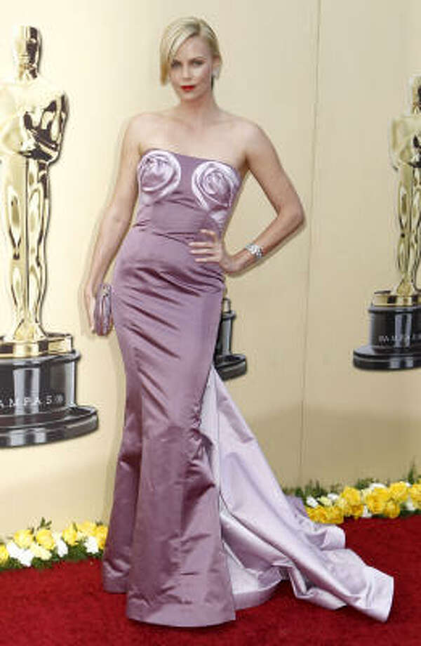 TOP HEAVY: Charlize Theron looked like she was wearing large blush-colored breast cups. Too distracting for words. Shall we say it was nipplesque? Photo: Matt Sayles, AP