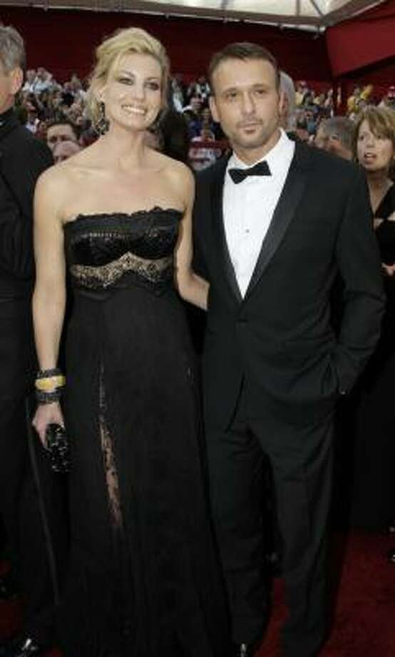 TONED DOWN: Faith Hill's black dress was almost too subdued. Photo: Amy Sancetta, AP