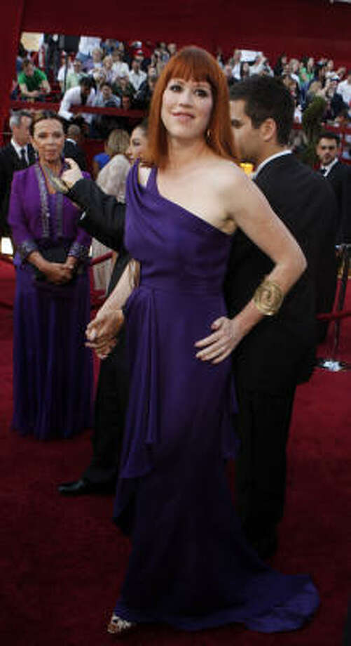 WHAT'S SHE DOING AT THE OSCARS? Purple seems to be a hot color on the red carpet, but it's just a hot mess on Molly Ringwald. Photo: Mark Boster, MCT