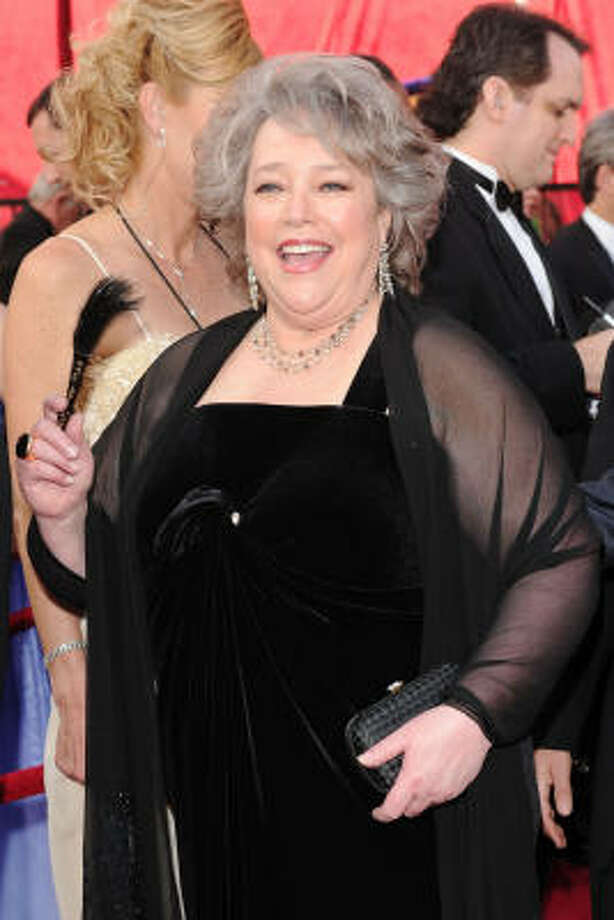 ALL TIED UP IN KNOTS: The knot on the front Kathy Bates' looks like the designer didn't have enough time for a fitting. And what's with the feather? Photo: Alberto E. Rodriguez, Getty Images