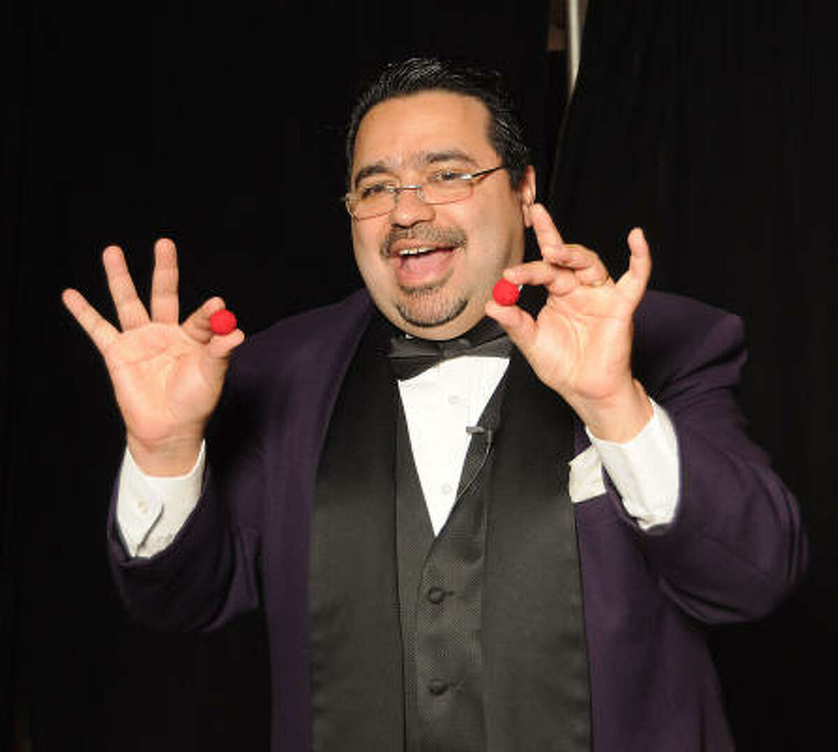 Magician Jamie Salinas works the crowd at the 'Do You Believe in Magic?' Gala at the Houston Museum of Natural Science.