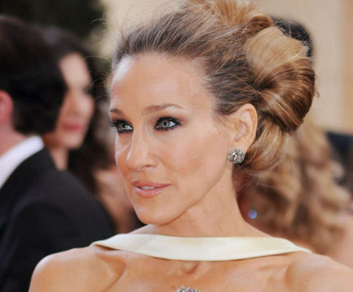 """Sarah Jessica Parker: Huge, huge, late '60s bun that channels """"Valley of the Dolls."""" Extra hair, necessary for this topiary of a coif, never looked so chic."""
