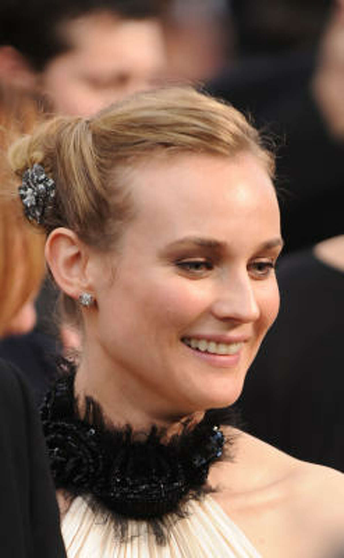 Diane Kruger: Hair swept back and tied in the back with lots of little knots. Glorious or inglorious? You decide.