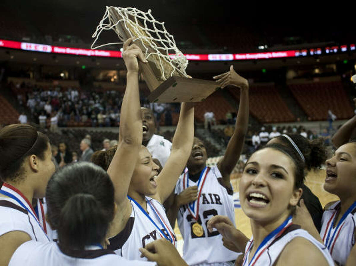 Cy-Fair's Danika Cervenka hoists the Class 5A state championship trophy with her teammates after Saturday's win over Hightower.