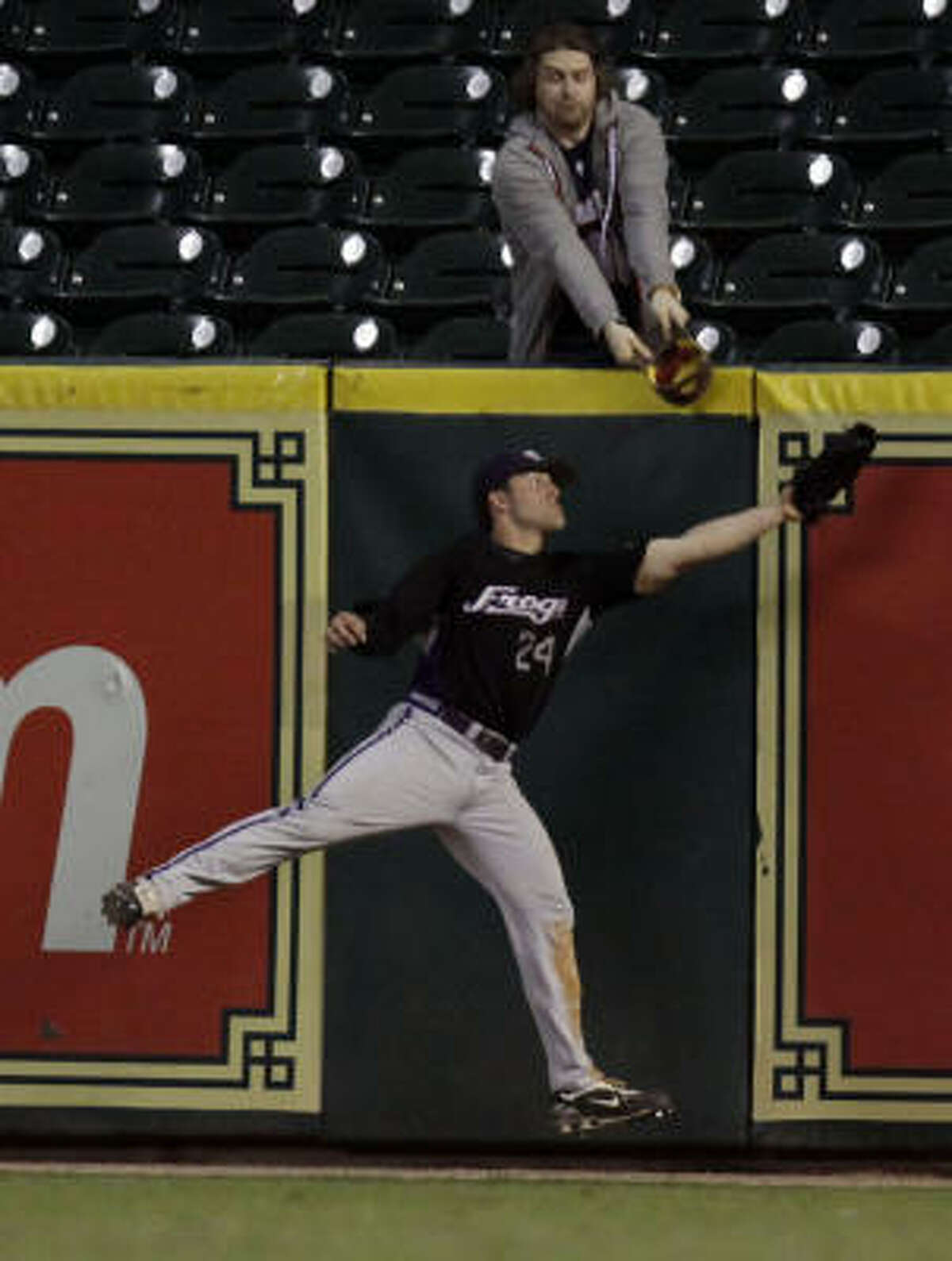 TCU RF Josh Elander (24) nabs a pop fly against Rice in the fifth inning on the final night of the Houston College Classic.