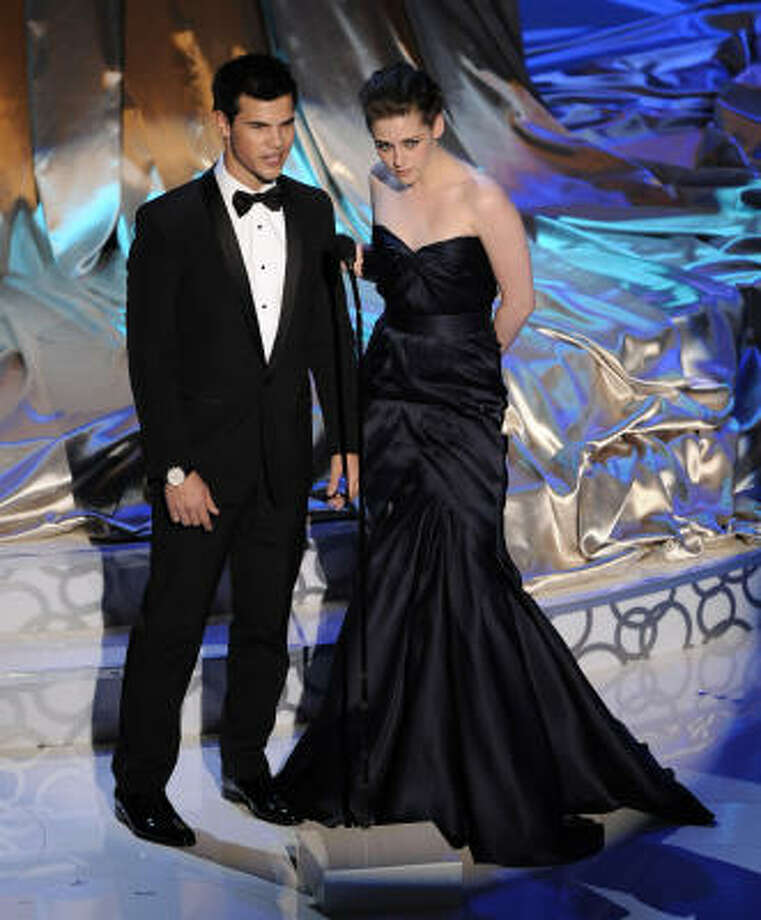 Right category, wrong presenters : Twilight stars Kristen Stewart, right, and Taylor Lautner introduce a tribute to horror films, most of which were popular before they were born. FAIL. Photo: Mark J. Terrill, AP
