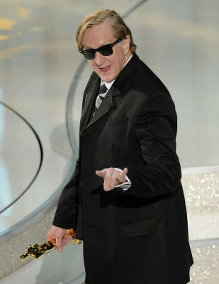 His future's so bright, he's gotta wear: T Bone Burnett  spent the night wearing shades indoors. Was the star power inside Kodak Theater that bright? Or was he blinded by his shiny Oscar? Photo: Mark J. Terrill, AP
