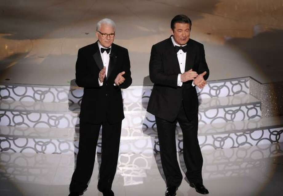"Dynamic duo: ""The biggest pair since Dolly Patron"" is how Neil Patrick Harris referred to co-hosts Steve Martin and Alec Baldwin Photo: Mark J. Terrill, AP"