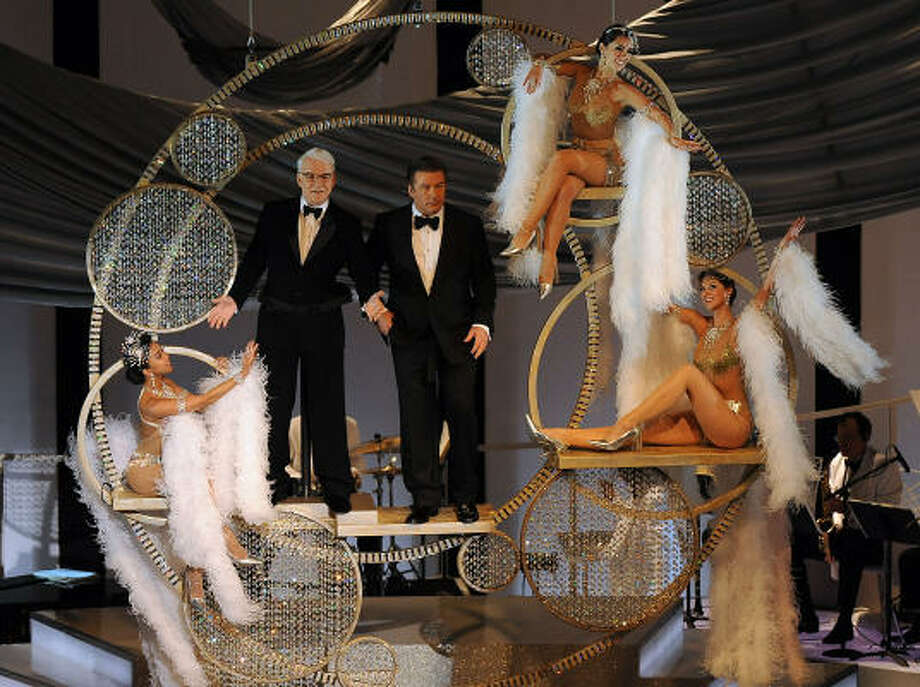 Look, up in the sky: Comedian Steve Martin, left, and actor Alec Baldwin, co-hosts, were lowered from the ceiling at the beginning of the show. Photo: GABRIEL BOUYS, AFP/Getty Images