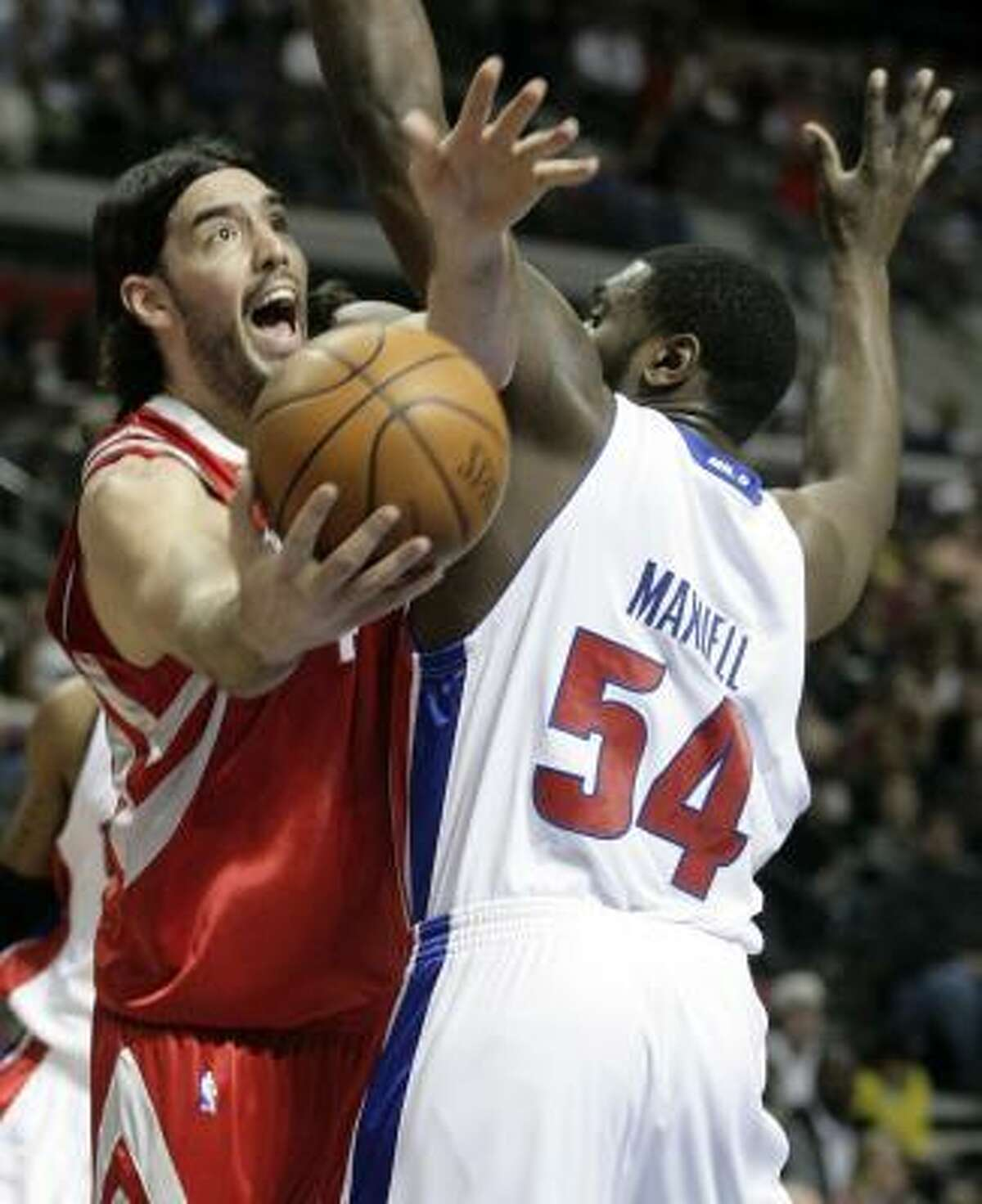 Rockets' Luis Scola, left, takes a shot around Detroit Pistons' Jason Maxiell (54) in the first half. Scola had a team high 15 rebounds and added 20 points.