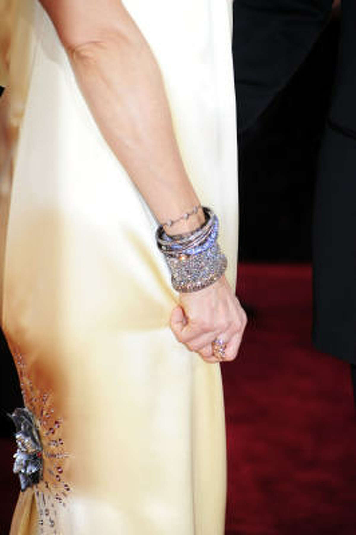 And the bracelets go perfectly with the gown.