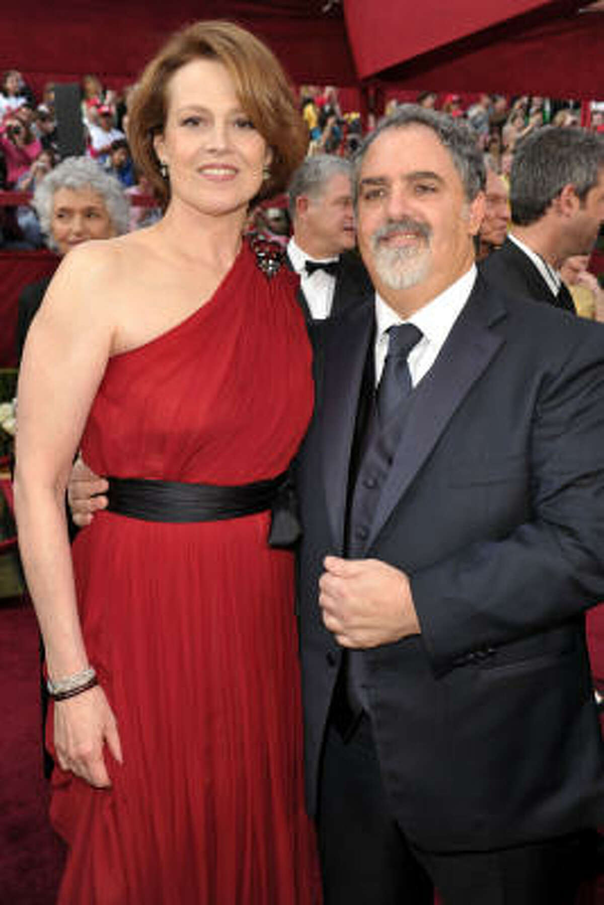 LADY IN RED: Sigourney Weaver's red one-shoulder dress by Lanvin was a show stopper on the red carepet, but we didn't like the black sash so much.