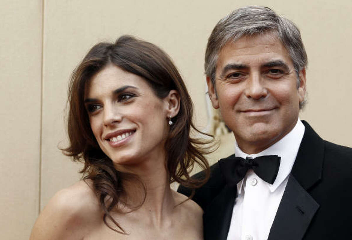 George Clooney and Elisabetta Canalis arrive.