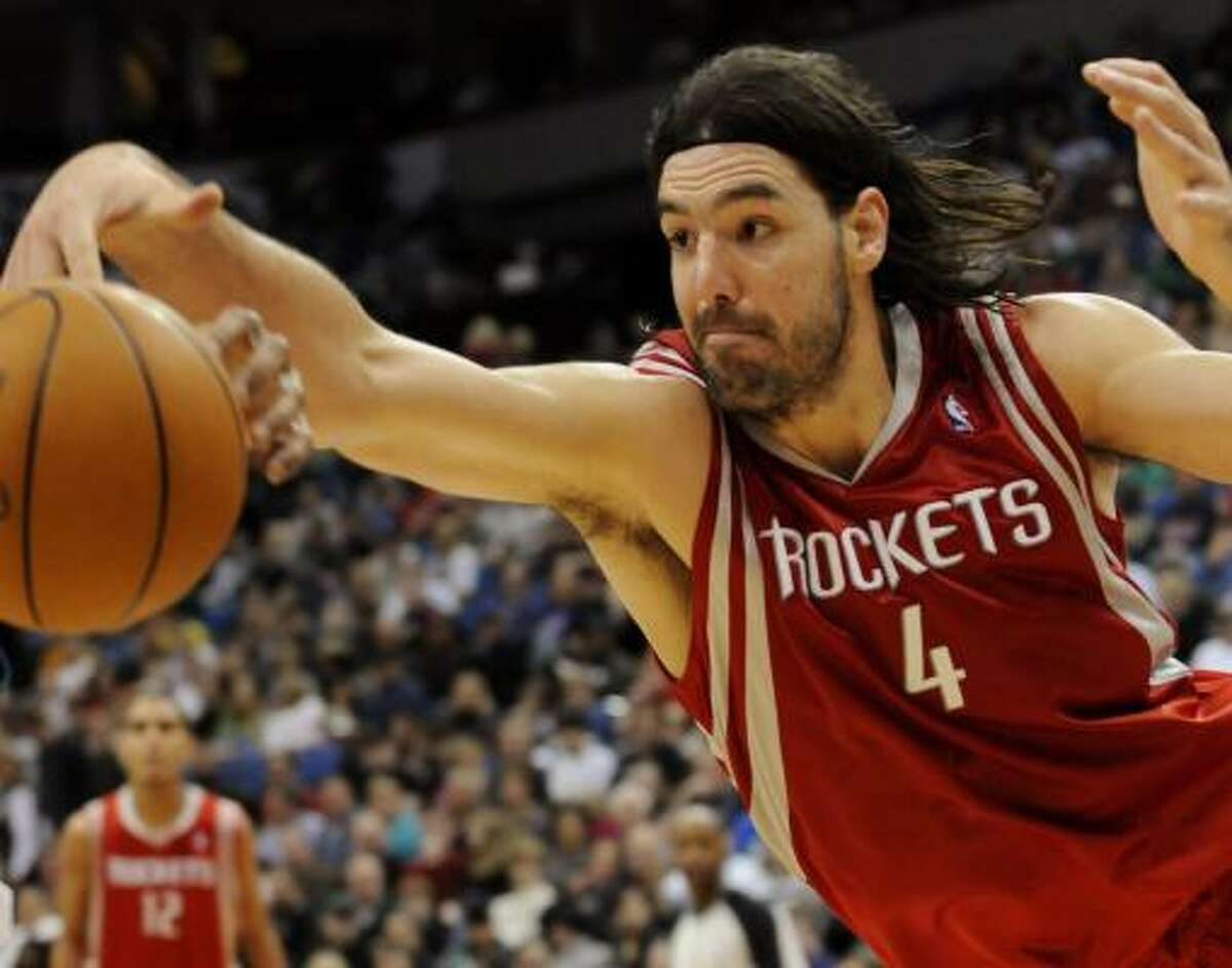 Luis Scola dives for a loose ball. Scola scored 25 points and pulled in 21 rebounds against the Timberwolves.