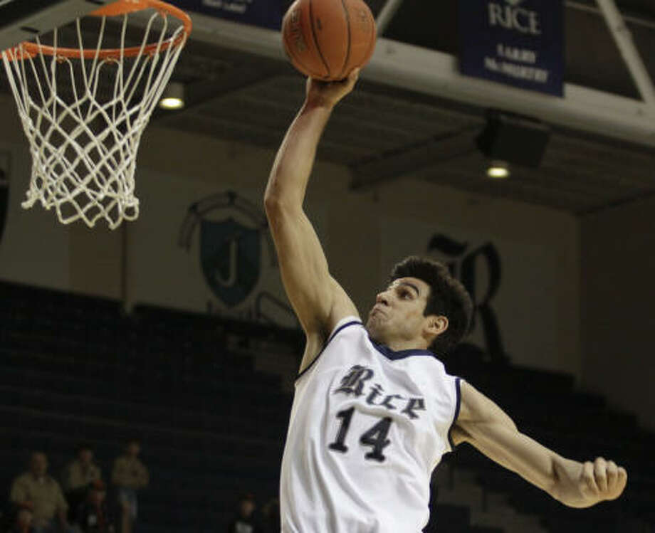 Rice forward Arsalan Kazemi provided some high-flying action in Saturday's game against Central Florida, but the Owls shot poorly en route to a 66-59 loss at Tudor Fieldhouse. Photo: Eric Kayne, For The Chronicle