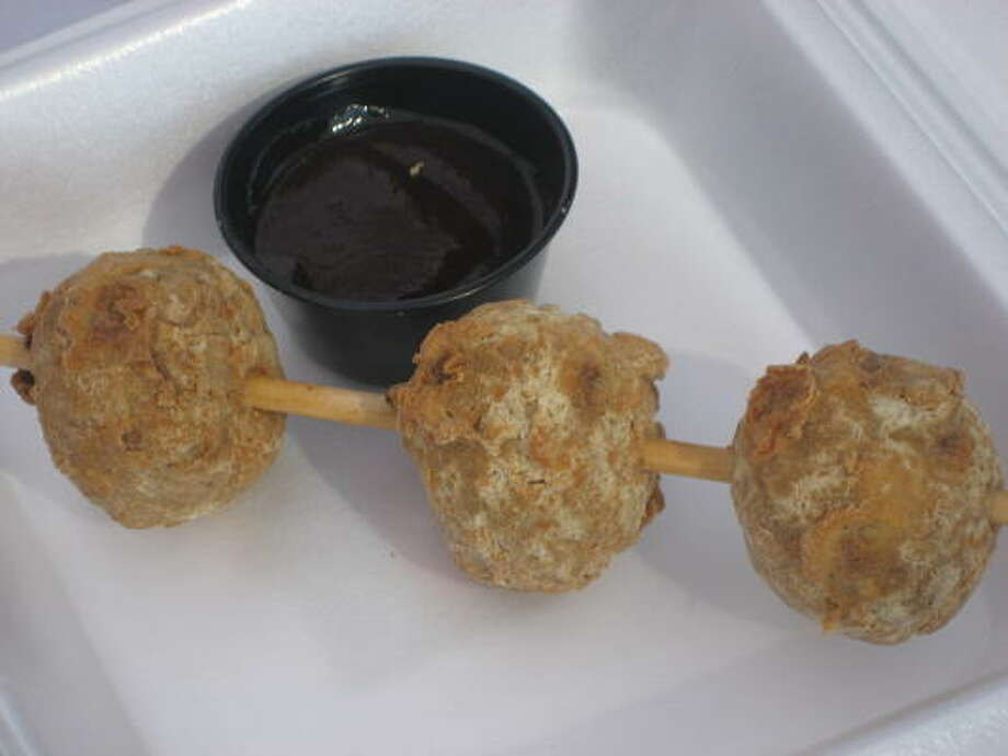 Chicken fried meatballs on a stick with BBQ dipping sauce Photo: Greg Morago, Chronicle