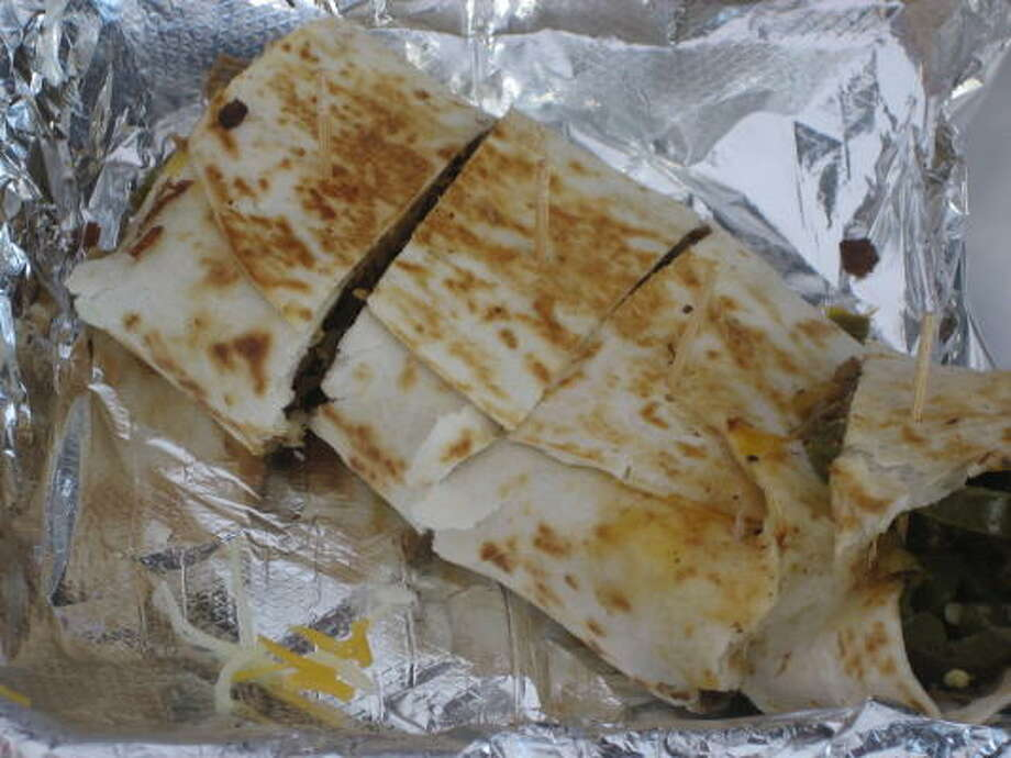 Grilled burrito stuffed with chopped beef and jalapenos Photo: Greg Morago, Chronicle