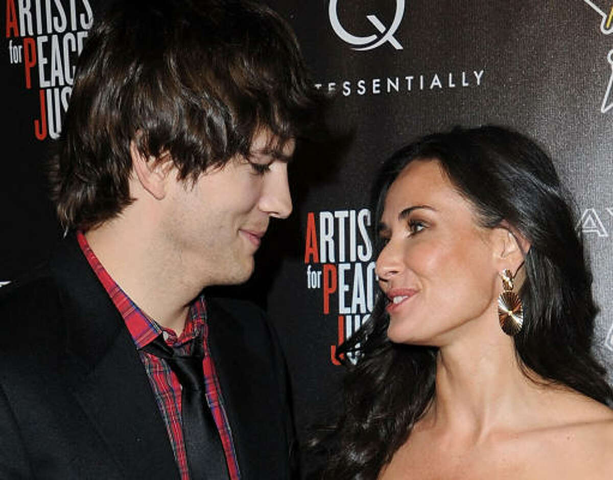 Demi Moore and Ashton Kutcher arrive at the Hollywood Domino's 3rd annual pre-oscar Hollywood gala.