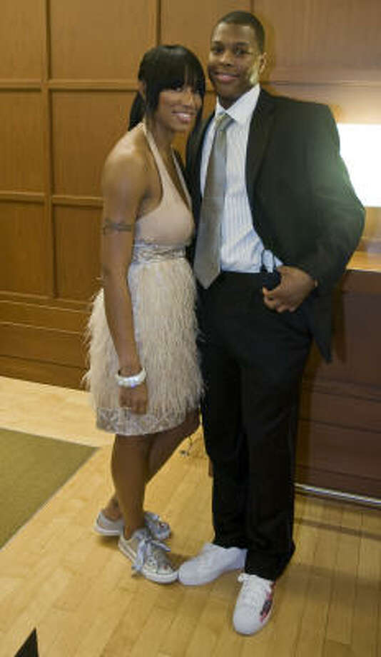 "Rockets Kyle Lowry and Ayahna Cornish pose for photographers at the Houston Rockets ""Tux and Tennies"" annual charity event at the Toyota Center on Thursday. Photo: James Nielsen, Chronicle"