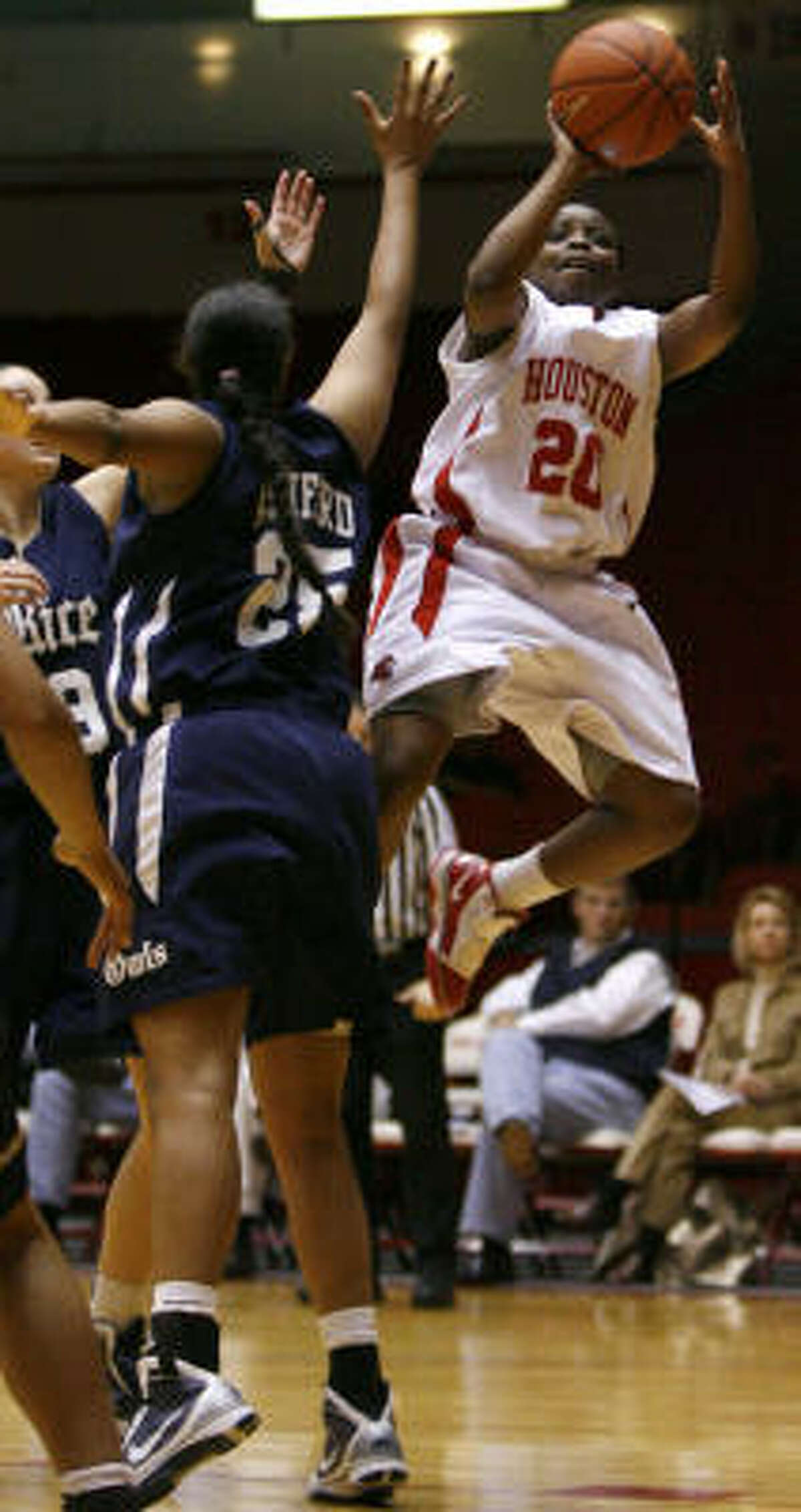 Houston's Porsche Landry goes up for a basket during the first half of the UH-Rice game at Hofheinz Pavilion.