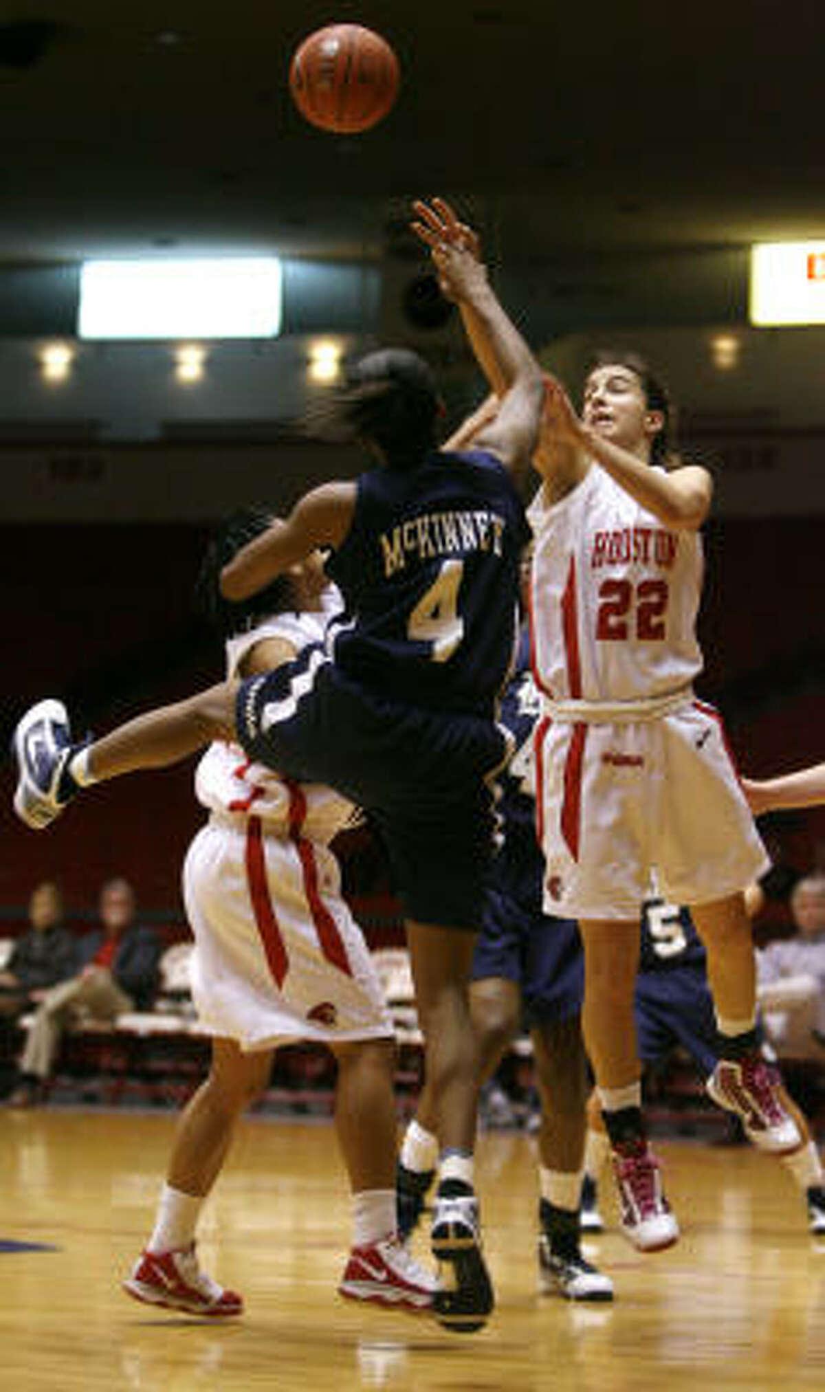 Houston's Roxana Button and Rice's Amenemope McKinney go up for a rebound.