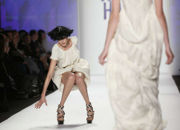 She pulls herself up and pulls it together in front of a crowd of fashionistas. Photo: FRANCOIS MORI, AP / HC