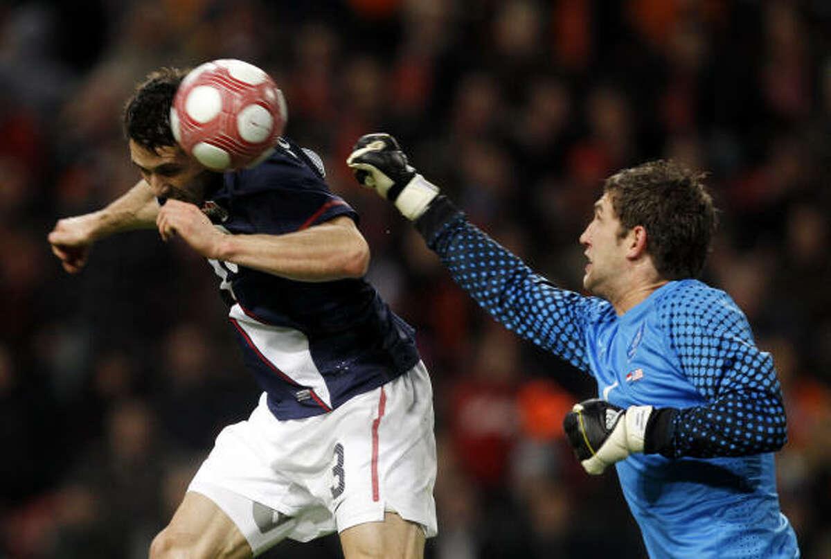 Carlos Bocanegra of the United States, left, scores a goal past goalkeeper Maarten Stekelenburg of the Netherlands. The United States fell to the Netherlands 2-1.